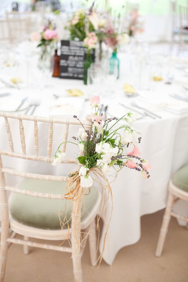 Limewashed chiavari chairs with sage green seat pads