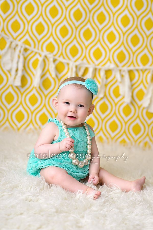 Caralee Case Photography.  Baby and Child Photographer.  Yellow Backdrop.6 months old.