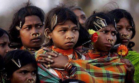 Indian tribal girls watch rituals in  the Niyamgiri hills. India has refused Vedanta Resources permission to mine bauxite in the area. Photo...