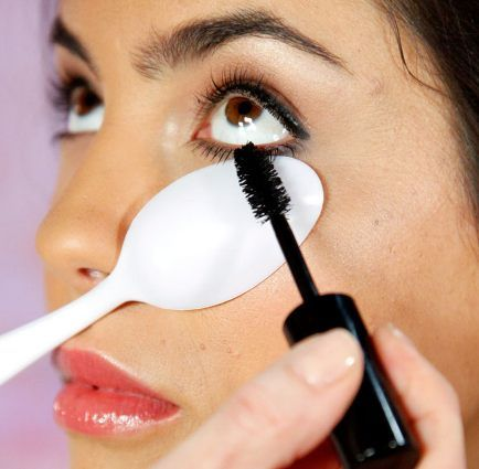 Use a plastic spoon to easily apply mascara on your bottom lashes without getting any on the skin under your eyes. It also helps you to acco...