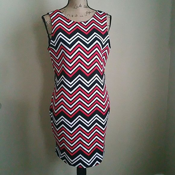 NWT Red/Black/White Zig-Zag Dress Red/Black/White Zig-Zag Dress with a Black and Gold Belt with an open back. Love Culture Dresses