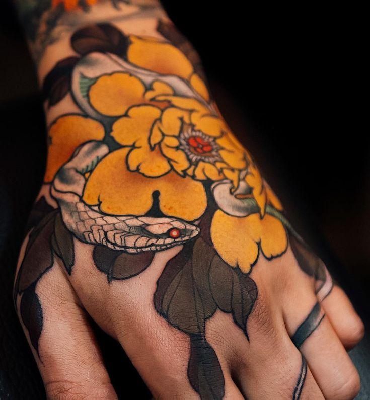 Japanese hand tattoo by @yuuztattooer.    #japaneseink #japanesetattoo #irezumi #tebori #colortattoo #colorfultattoo #cooltattoo #largetattoo #handtattoo #snaketattoo #flowertattoo #peonytattoo #newschool #newschooltattoo #blackwork #blackink #blacktattoo #wavetattoo #naturetattoo