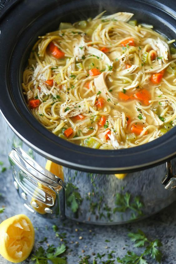 Slow Cooker Chicken Noodle Soup - Made right in the crockpot! So hearty, comforting and soothing. Perfect during the cold weather or fighting off a cold!