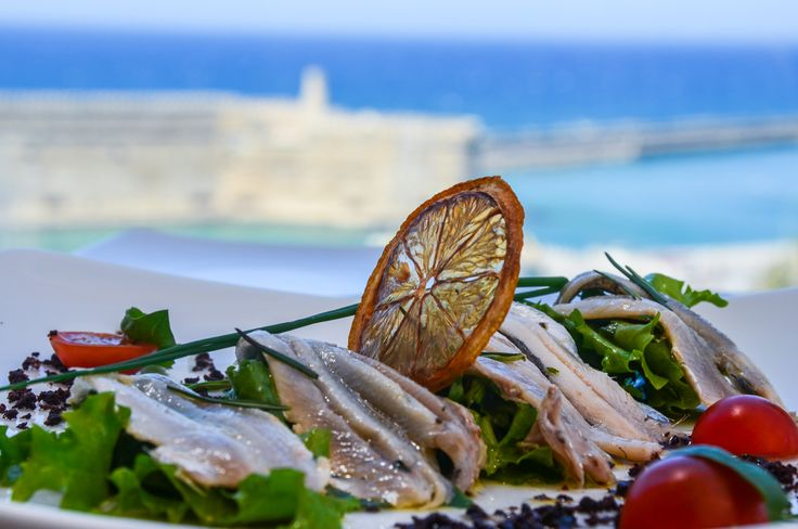 "A splendid sea food dish from our new Chef Zinonas Christofidis, to accompany a shot of traditional Cretan ""raki"" in our Herbs' Garden restaurant overlooking the Venetian castle and the endless blue of the Cretan Sea."