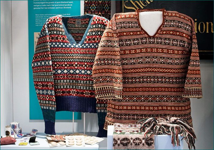 """two traditional Fair Isle jumpers with characteristic limited color palette, bands of larger motifs and smaller peeries, and two colors per row ... from Shetland Museum collection. """"The 1920s was the golden age of Fair Isle knitting. It was hugely fashionable and knitters created many new designs during this period. © Mark Sinclair / Phatsheep Photography"""