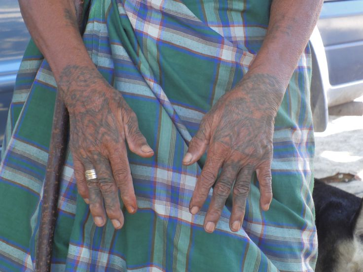 Nice traditional Timorese pattern tattoos on old woman's hands. Atambua, Nusa Tenggara Timur