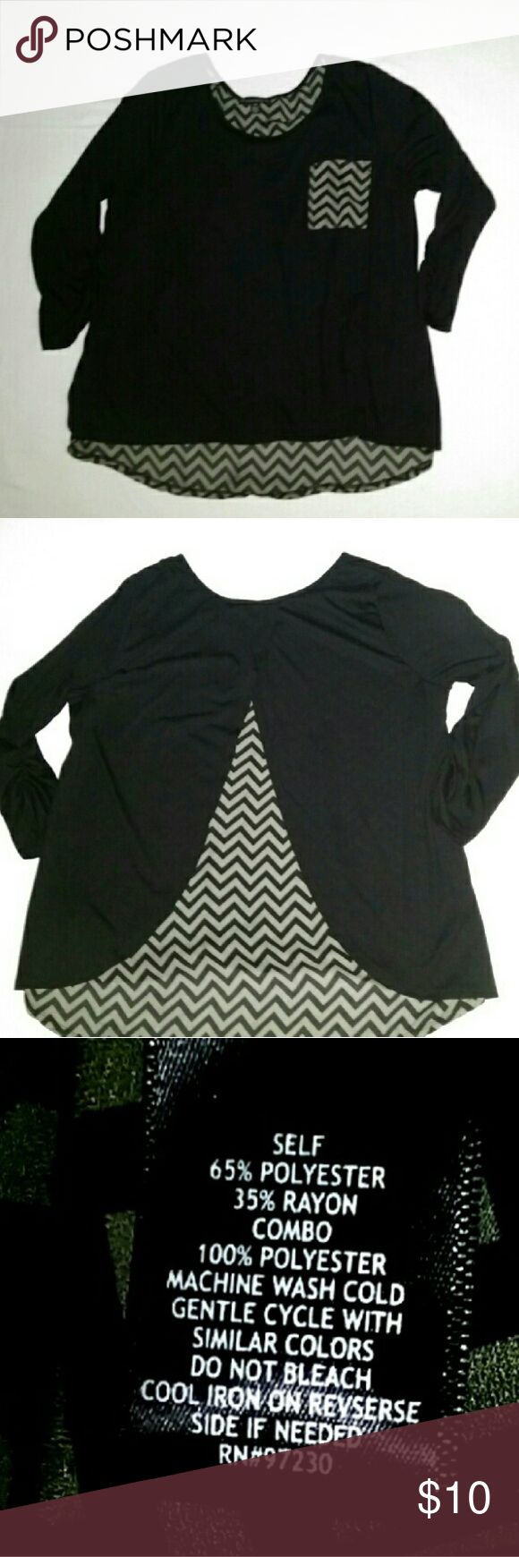 NWOT Large Black & Gray Chevron Pocket Top NWOT Large Contemporary Style Signature Studio Black & Gray Chevron Pocket Top. Never worn. 3/4 length sleeves.  From the front, it looks like a black shirt with a chevron pocket. From the back, the black material splits at the back of the neck and from underneath, the gray chevron pattern hangs down further than the rest of the shirt. Picture shows it better than I can explain it, I just didn't want anyone to be mislead from the front view picture…