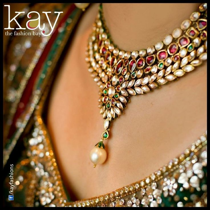 The best chain to wear for a V neck shaped dress is a pendent that is also in V pattern, fitting perfectly. .