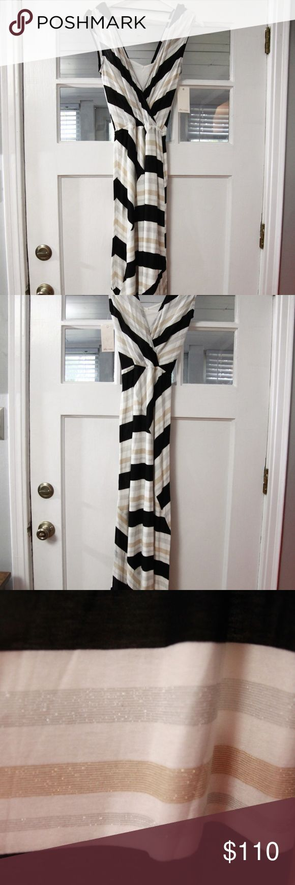 Ella Moss Maxi Dress Sz S New! Black Gold Silver Ella Moss maxi dress in size small. Rayon blend, dry clean. 1/2 in hole in lining (does not affect wear).  Measurements Bust 36 inches Length 59 inches shoulder down inventory 15-107 Ella Moss Dresses Maxi
