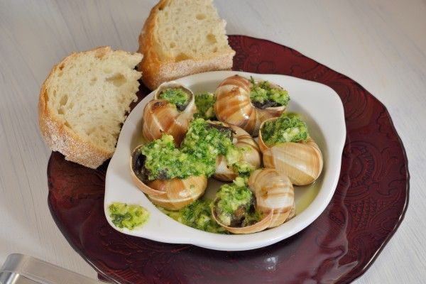 Escargots à la Bourguignonne Vol-Au-Vent (Snails in Garlic–Herb Butter with Puff Pastry)- A timeless French recipe, snails in garlic-herb butter and puff pastry recipes will get your mouth watering for more. You won't believe how easy and CHEAP they are to make. Perfect for dinner parties or feeding a crowd.