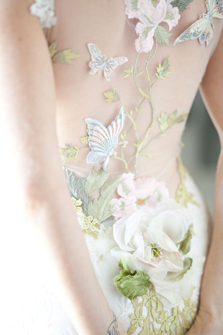 Claire Pettibone dress - butterfly and garden embroidery  Photography: Lucy Munoz - lucymunozphotography.com  View entire slideshow: Top Dresses of 2014 on http://www.stylemepretty.com/collection/906/