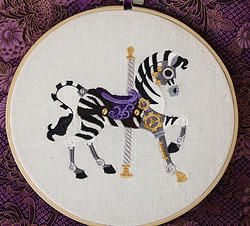 """Carosel Zebra""  8"" machine embroidered hoop art. Can be personalised for your childs room. Finished with stiffened felt for your wall's protection. $24.00 #embroidered #hoop #art #embroideredhoopart"