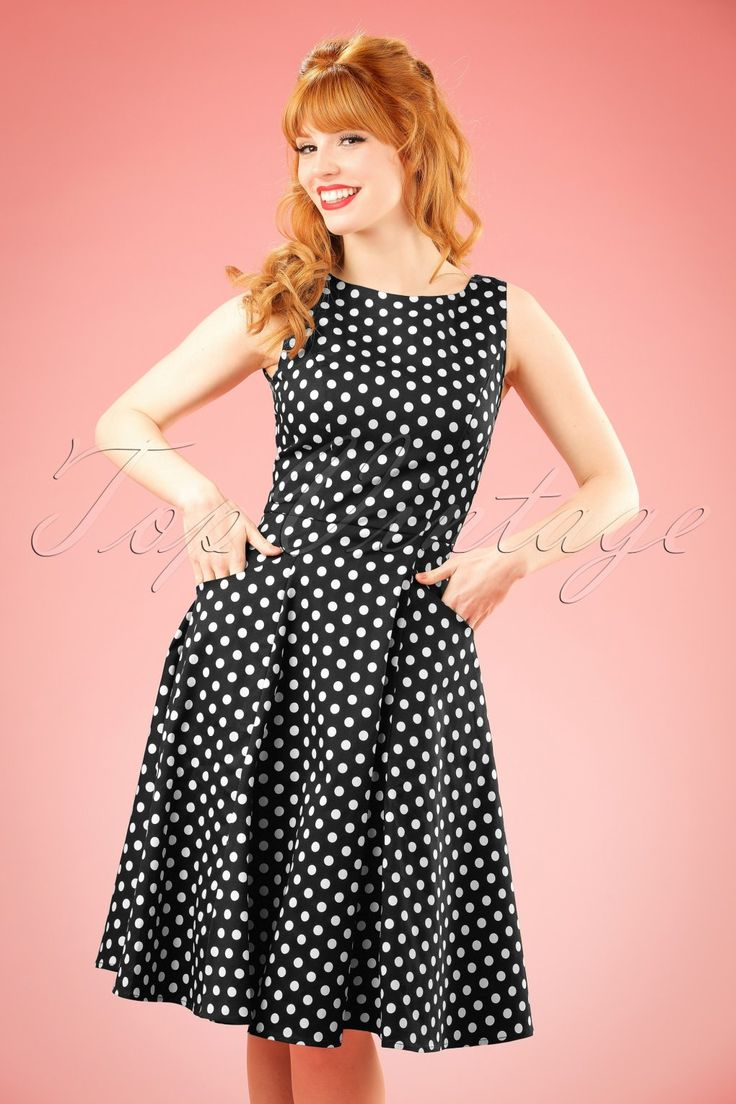 Her name says it all; Audrey Hepburn would have worn this 50s Hepburn Polkadot Doll Dress proudly!Elegant boat neck, sexy V-back and playful white polkadots, what a stunner...The fitted top and semi-swing skirt ensure a feminine and flirty silhouette, oh la la! Made from a black cotton blend with a light stretch for a perfect fit. Put on your pumps and do it like Audrey! ;-)  Boat neck V-back Pockets at the front Zipper at the back Our stunning redhead Vanessa Frankenstei...