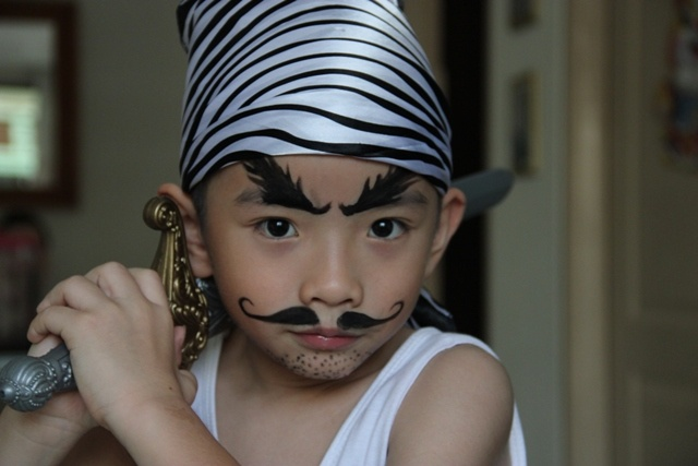Simple pirate face paint (Eyebrow pencils?) and temporary tattoos