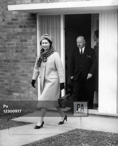 Queen Elizabeth II visiting a new home during her visit of Stevenage New Town, Hertfordshire.