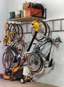 Wall Mounted - one level garage storing system that fit a lot of bikes plus yard appliances in a small corner.
