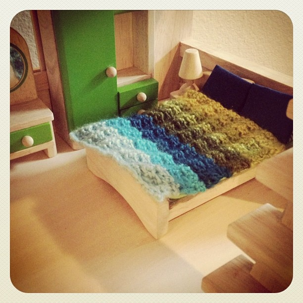 Crocheted @Bernat Yarns Sheep(ish) Scarf swatch turned dollhouse bed blanket.