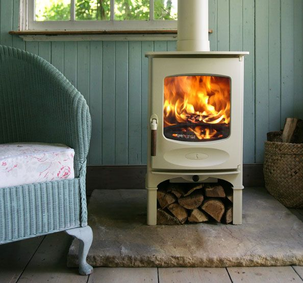 This time of year we always talk about putting in a fireplace or wood stove.  I really like this one.  Small, nice color. Vermont cabin wood stove