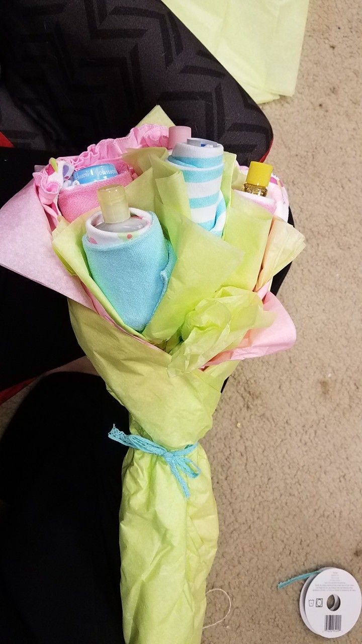 Travel bottle and wash cloth flower bouquet.