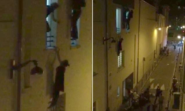 """{   'HELP, HELP, I'M PREGNANT!': TERRIFIED WOMAN CALLED FOR HELP AS SHE DESPERATELY HELD ON TO A SECOND FLOOR WINDOW LEDGE OUTSIDE THE BATACLAN THEATRE TO ESCAPE GUNMEN   } #DailyMailUK ..... """"Video footage shows pregnant woman desperately hanging from a window ledge as she tries to hide from gunmen""""…"""