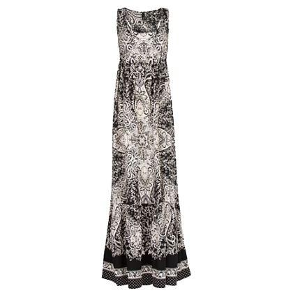 Mouwloze bedrukte lange jurk, vervaardigd in een lichte stof. Empire taille, ronde hals, racerback, verborgen zijzakken en boord met ruche.