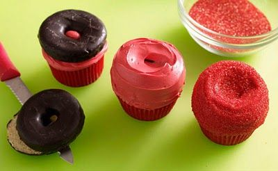 Apple cupcakes made with a donut topper, red sanding sugar, tootsie roll and green fruit chews.