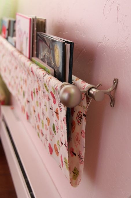 Love this! Using a curtain rod and fabric to make a kids book shelf! Put it by the bed!