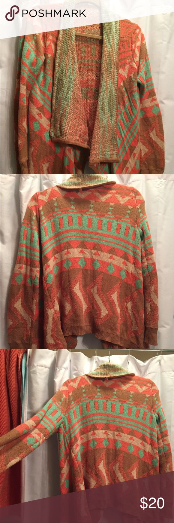 Tribal sweater size small Love this sweater. It's a small, but fits like a medium. I have too many tribals and need to size down my closet. Blu Pepper Sweaters Cardigans