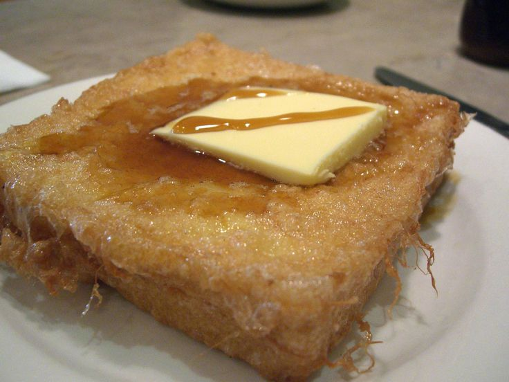 Hong Kong-style French #toast (#西多士) is listed at number 38 on the World's 50 most delicious foods compiled by CNN Go in 2011. It is made by deep-frying stacked sliced #bread dipped in beaten egg or soy, served with a slab of butter and topped with golden syrup, or sometimes honey. Two slices are normally used and a sweet filling is usually added.