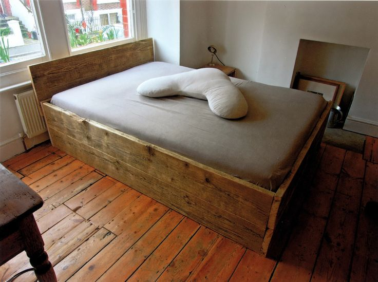 Wooden double bed base with headboard made from solid reclaimed timber by Naturalcity on Etsy https://www.etsy.com/uk/listing/121167827/wooden-double-bed-base-with-headboard