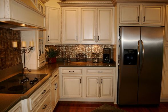 Bold Backsplash, We recently added an easy-to-clean faux tin backsplash as well as pendant lights to our kitchen., Kitchens Design