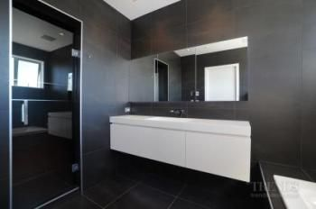 Monochromatic & dramatic,this bathroom was brought together by Yellowfox using the company's trusted suppliers & craftspeople.  #monochrome #bathroomdesign