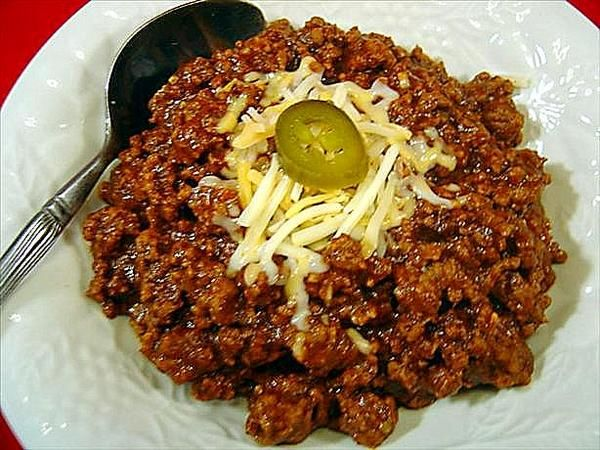 "Easy Chili Con Carne (No Beans)  ""Some people like beans in their chili, some do not. This chili has no beans, but if you like beans, you can easily add them. This beanless version is perfect for having with chili dogs, chili burgers, or just a warm bowl full on a chilly day."""