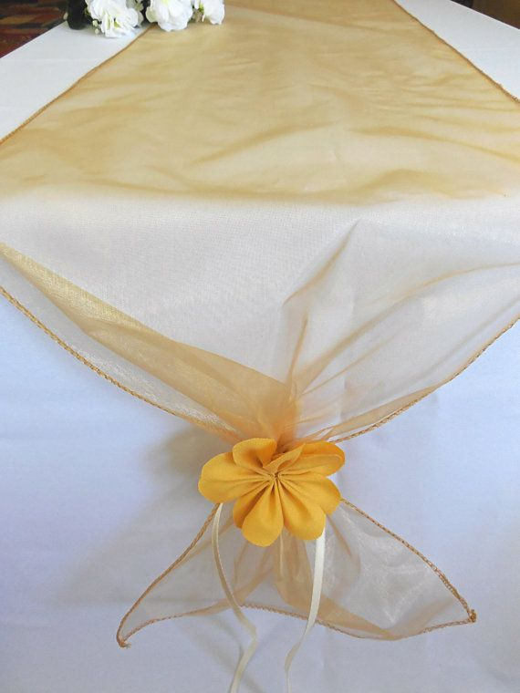 This is a beautiful organza table runner in a sheer gold color, very light and elegant for your event table.  It is 12 wide, and 108 long.  I