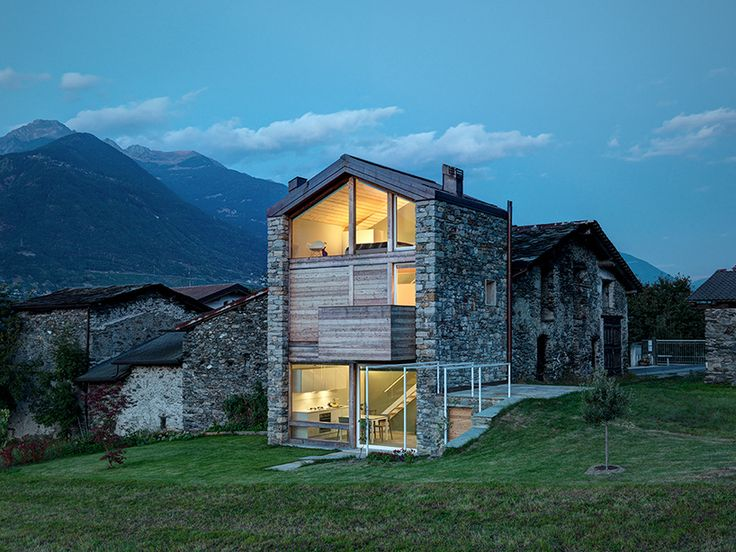 the simple structure comprises two existing stone walls, while the upper storey, including its façade and roof, is made of wood.