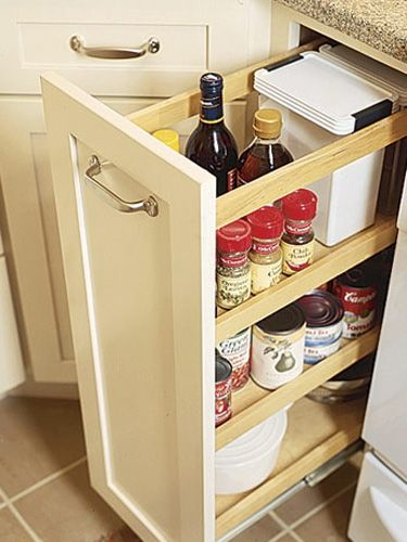 Another great solution for not having space for a dedicated pantry? Cabinet manufacturers offer slide-out units that fit into standard base-cabinet openings, or gaps between cabinets.