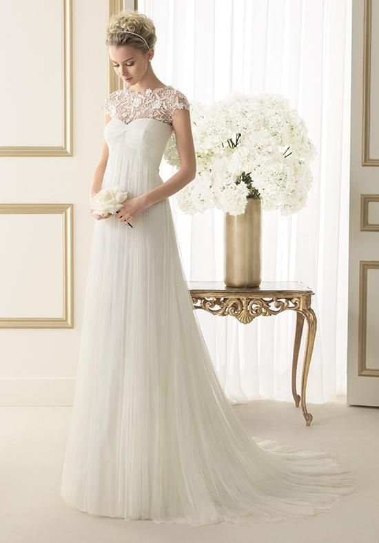 Softly draped tulle sheath gown with empire waist and a sweetheart illusion neckline | Luna Novias | https://www.theknot.com/fashion/123-elixir-luna-novias-wedding-dress