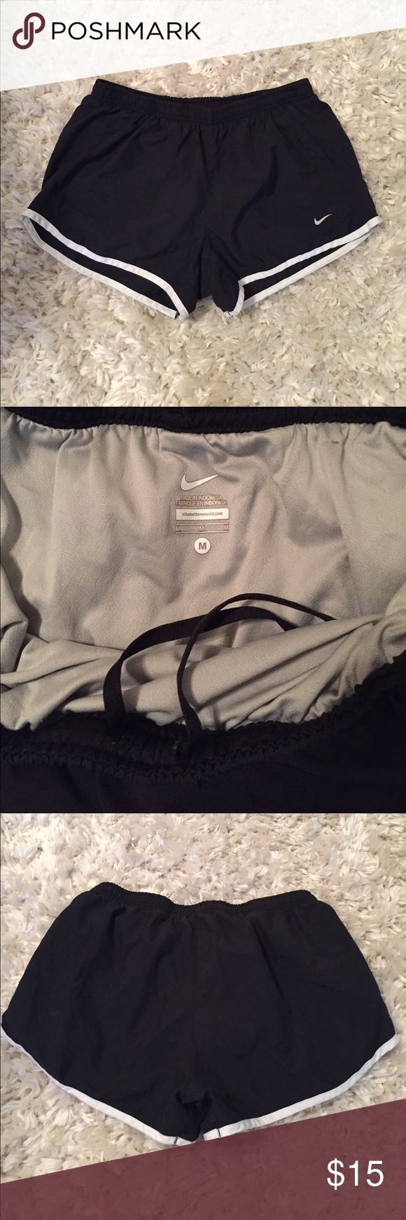 Medium black Nike shorts Medium black Nike shorts with adjustable string in the front to make the shorts tighter or looser. Have been worn but are in great condition. Nike Shorts