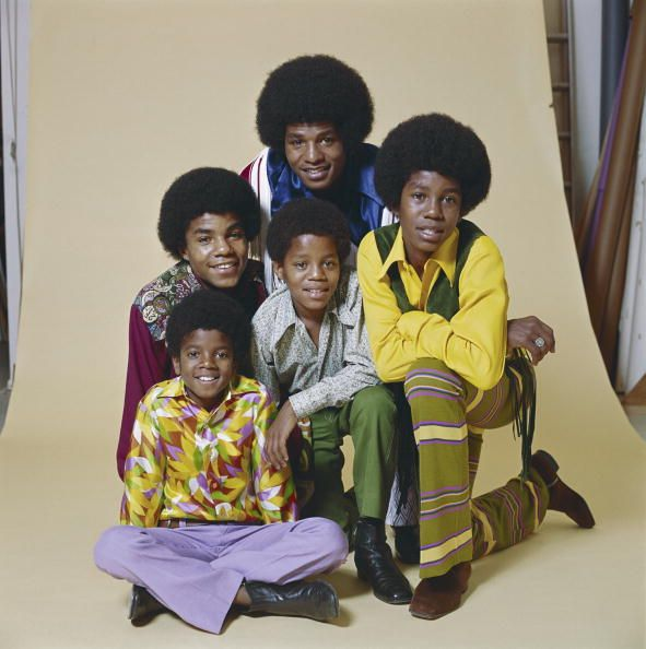 B quintet 'Jackson Five' pose for a studio portrait in January 1971 in Los Angeles California Clockwise from bottom left Michael Jackson Tito Jackson...
