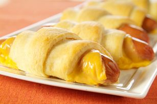 Cheesy Mummy Wrapped Dogs recipe (just a good finger food to keep in mind. mmm, also, slice when done so they're more finger-foodish)