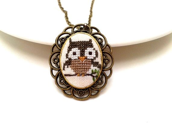 Hand embroidered Little Owl necklace. The Owl has been delicately hand embroided in cross stitch on a cream linen fabric with color cotton embroidery