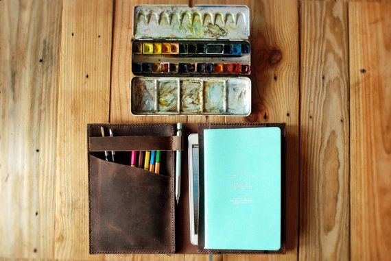 This leather cover stores and stashes a notebook, a few colored pencils and an iPad mini.