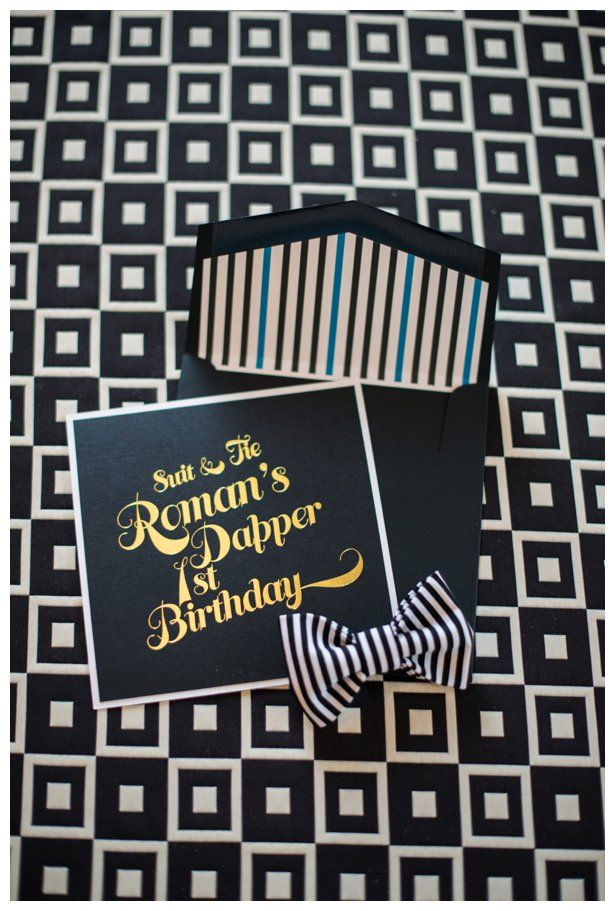 A dapper boy first birthday party invitation! Black with Gold Foil Font, White, and Blue pin striping detail on the envelope insert. Celebrating a stylish little guy with bow ties, pinstripes and black and white geometric details.