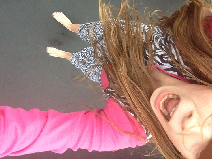 On the trampoline in my onesie. I'm in the air