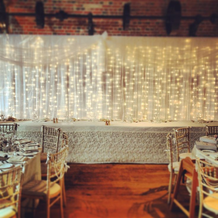 Beautiful bespoke handmade twinkly light backdrop draping designed and hand made by Mediterranean Occasions venue stylist.  www.MediterraneanOccasions.co.uk  Venue Gaynes Park - www.gaynespark.co.uk   Image by Gaynes Park.