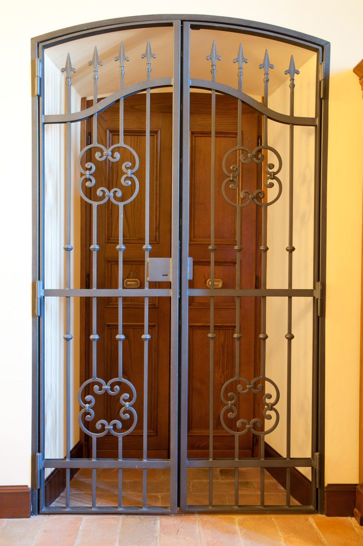 Decoration, Stunning Wrought Iron Doors Design With Twin Carving Style And Yellow Wall Also Brown Wooden Door: Wrought Iron Doors Ideas Can Give A Majestic Touch To Your Home