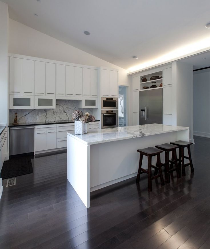 White and marble kitchen with dark timber tile floor