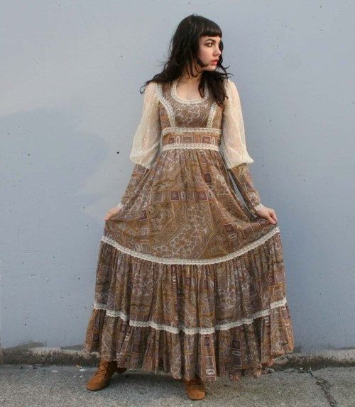 gunne sax dress...very much like my 8th grade graduation (1975) dress...except mine had a hood in the back too! I loved that dress...it was the first store bought dress I had ever had...I wore it until I was in my 20s...