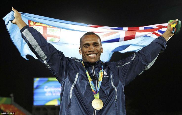 Osea Kolinisau posed with the Fijian flag following the historic win