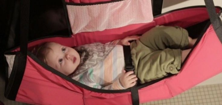 Baby Change-N-Go Is A Portable Changing Table That Hangs On The Bathroom Stall Door